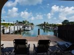 'RARE' & unobstructed beautiful rear canal VIEWS, relax on new loungers or dine on table & chairs!