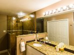 The Master bathroom has 2 sinks, a granite counter and a large shower with multiple shower heads