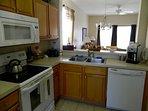 Full kitchen with Fridge, stove, dishwasher, microwave.