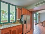 The fully equipped kitchen with stainless steel appliances makes cooking at home convenient.