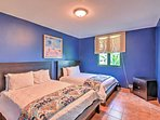 2 queen-sized beds offer ample sleeping space in this bedroom.