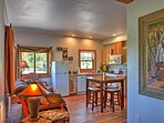 Sleek hardwood floors are illuminated by bright natural light.