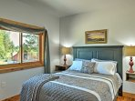 The guest bedroom features a comfortable queen-sized bed.