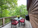 Back deck dining area and grill.