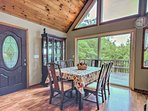 Guests can enjoy their meals at the dining table by the sliding glass door.