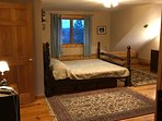 The four poster has a custom matteress and the space to stretch, relax  Double window faces lake
