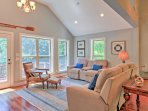 Relax on the comfortable furniture in the living room, which looks out onto the lake.