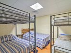 The fourth bedroom features a king-sized bed, a full-over-full bunk bed, and a twin-over-twin bunk bed.
