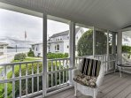You'll love lounging on the porch overlooking Onset Bay.