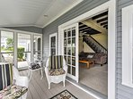 The covered porch will quickly become your favorite room in the house to relax.