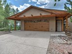 You'll love all the outdoor feels this property has to offer, nestled on a wooded lot with stunning mountain views.