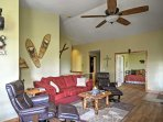 Make yourself at home in this cozy living room and sink into the plush sofa or one of the leather reclining chairs.