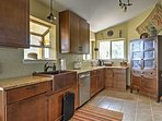 Prepare delicious home-cooked meals in the fully equipped kitchen.