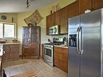 The space features stainless steel appliances, granite countertops, and all the cookware you'll need.