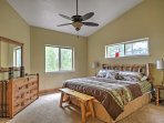 The master bedroom contains a plush king-sized bed for your comfort.
