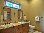 His-and-hers sinks are located in the ensuite bathroom of the master bedroom.