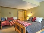 This room offers a full-sized bed as well as a twin-sized bed.