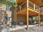 Enjoy fresh air from the outdoor patio or spacious covered deck.