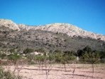 El Capricho surrounded by mountains and olivegroves