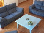 Livingroom with flatscreen, logburner and WIFI.