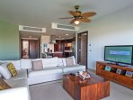 Living room with flat screen HDTV and ocean view