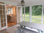 Dining area on screened porch just steps away from the kitchen.