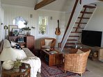 Most of the furniture in the living room was handmade from salvaged wood on the island by us.
