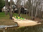 Beach with Kayaks and a new Paddleboard