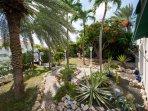 Lush tropical garden surrounds this villa.
