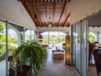 The lounge area at the porch, if desired out of the wind by the sliding glass doors.