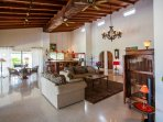 The living area indoors has a high ceiling which gives a very spacious feeling.