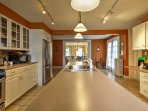 This enormous kitchen comes fully equipped with all the essential cooking appliances