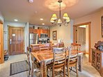 You'll love enjoying home-cooked meals at this spacious dining table.
