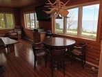Entertainment area and dining table with a gorgeous view