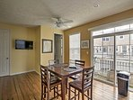 Enjoy a meal at this high-top dining table, along with your favorite show on the flat-screen cable TV.