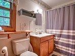 The en suite bathroom boasts new appliances and fixtures.