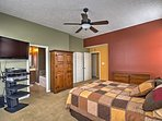 The master bedroom comes equipped with a flat-screen cable TV and full en-suite bathroom.