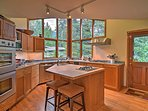 The kitchen is a chef's dream with a large island, double oven and all the essentials to prepare your favorite...
