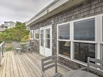 Sit back and relax on the back deck with 2 outdoor tables and seating for 8.