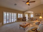 Ceiling fans and charming plantation shutters shade and cool the home.