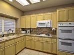 Ample kitchen amenities make your stay stress free.
