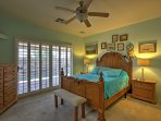 Two guest bedrooms feature comfortable full-sized beds.