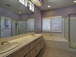 Sink into a soaking tub or refresh in the walk-in shower.