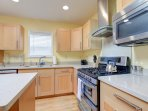 Features a fully functional kitchen complete with cooking and dining wares, also a full-size ref