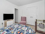 1st bedroom has a queen bed and crib, convenient for those traveling with toddlers and infants.