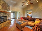 Relax in the comfortable living area, complete with couches and a stone fireplace.