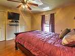 The master bedroom offers a queen-sized bed and has a flat-screen cable TV.