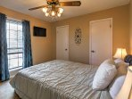 The second bedroom offers a queen-sized bed and flat-screen cable TV.