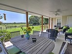 Everyone will look forward to unwinding on the furnished covered porch.