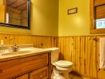 The upstairs bathroom offers a stand-up shower with single vanity.
